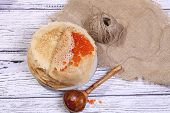 Pancakes With Red Caviar And A Wooden Spoon