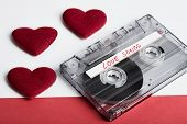 Audio Cassette Tape On Red Backgound With Fabric Heart