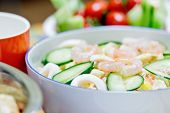 Delicious salad with shrimps squid and vegetables