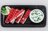 Grilled surimi sticks a form of kamaboko, a processed seafood made of white fish flesh with garlic dip