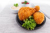 Fried chicken drumsticks with dips