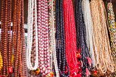 stock photo of prayer beads  - Strands of prayer beads in a shop in India - JPG