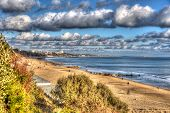 Branksome beach Poole Dorset England UK with cloudscape near to Bournemouth like painting in vivid b