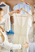 Elegant female choosing new dress