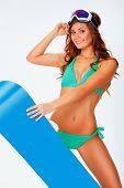 woman wearing bikini and snowboard