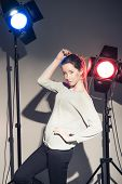 Woman posing in light flashes