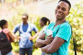 cheerful african american college boy on campus