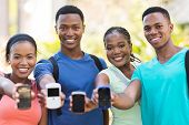 group african college students showing smart phones
