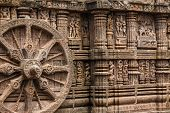 picture of chariot  - A chariot wheel carved into the wall of the sun temple at Konark - JPG
