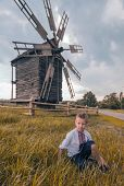 picture of national costume  - boy at the field near old mill in national costume - JPG