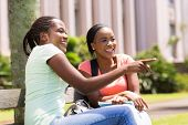 beautiful young african college students sitting outdoors