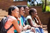 group of happy african college students looking away