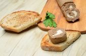 Roll pate and slices of toasted bread