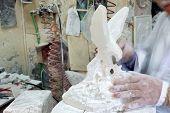 Artist Sculpting Alabaster