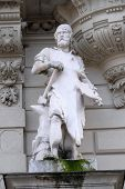 GRAZ, AUSTRIA - JANUARY 10, 2015: Statue of Industry, allegorical representation, detail of Rathaus Town Hall, Graz, Styria, Austria on January 10, 2015.;