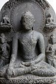 KOLKATA, INDIA - FEBRUARY 15:  Buddha seated in bhumisparsha, from 10th century found in Basalt, Bihar now exposed in the Indian Museum in Kolkata, on February 15, 2014
