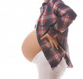 pregnant caucasian woman closeup body isolated on white background studio shot side view