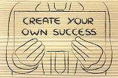 Business Man Holding Sign Saying Create Your Own Success