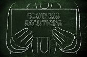 Business Man Holding Sign About Business Solution
