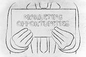Business Man Holding Sign Saying Marketing Opportunities
