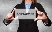 Businesswoman Holding Sign Contact Us