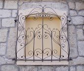 Decorative Wrought Iron Grille On Walled Window