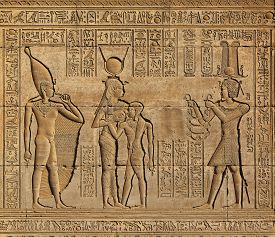 picture of hieroglyphic  - Hieroglyphic carvings on the exterior walls of an ancient egyptian temple  - JPG