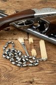 pic of hunt-shotgun  - hunting gun with cleaning kit on a wooden table - JPG