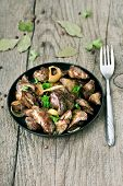 image of liver fry  - Roasted chicken liver in frying pan and fork on wooden table - JPG