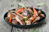 picture of liver fry  - Grilled chicken liver in frying pan on rustic table - JPG