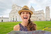 image of piazza  - A happy female tourist bursts out laughing as she realizes that she - JPG