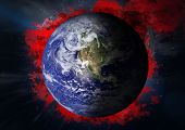 stock photo of outer  - Earth with red smoke against outer space - JPG