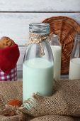 picture of sackcloth  - Milk in glassware and walnuts on wooden table with sackcloth - JPG