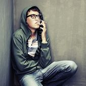 picture of teen smoking  - Young man in depression smoking a cigarette - JPG