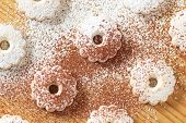 image of sprinkling  - Italian canestrelli cookies on a wooden table sprinkled with powdered sugar and cocoa - JPG
