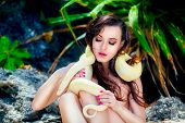 pic of jungle snake  - portrait of the beatiful girl with dangerous snake in the tropical jungle - JPG