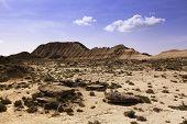 stock photo of arid  - Arid landscape at daytime in Bardenas Reales Navarra Spain - JPG
