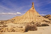 image of arid  - arid landscape Bardenas Reales Navarra Spain This particular rock formation is named cabezo Castildetierra - JPG