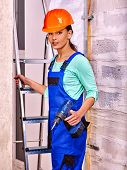 pic of millwright  - Young woman in blue builder uniform indoor - JPG