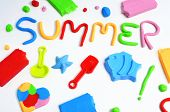 stock photo of molding clay  - the text summer made from modelling clay of different colors and some beach toys such as toy shovels and sand moulds - JPG