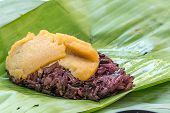 image of custard  - Black Sticky rice with custard wrapped in banana leaves - JPG