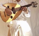 foto of organist  - arab musician playing traditional stringed instrument the oud - JPG
