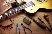 Постер, плакат: Guitar on guitar repair desk Vintage electric guitar on a guitar repair work shop Single cutaway s