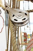 pic of rig  - Closeup of old metal block and rigging at the yacht - JPG