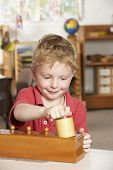 picture of montessori school  - Young Boy Playing at Montessori - JPG