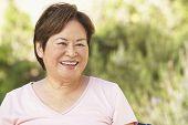 Smiling Senior Woman In Garden