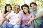 stock photo of grown up  - Grandparents With Adult Children In Park - JPG