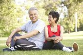 stock photo of beautiful senior woman  - Senior Couple Resting After Exercise - JPG