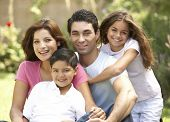 stock photo of ten years old  - Family Enjoying Day In Park - JPG