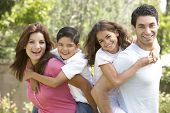 pic of ten years old  - Portrait of Happy Family In Park - JPG